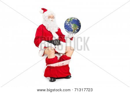 Santa holding the planet in hand seated on toilet isolated on white background, earth image in Public Domain and furnished by NASA