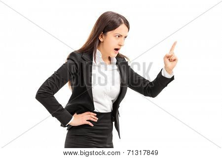 Angry businesswoman threatening with finger isolated against white background