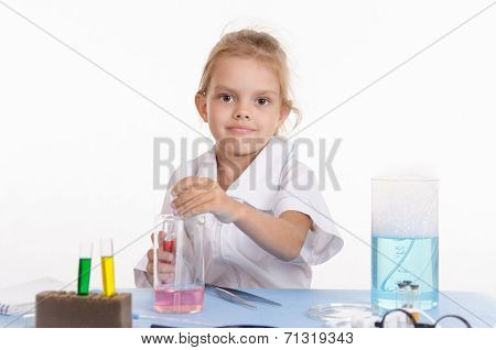 Schoolgirl Conducts Experiments In Chemistry Class
