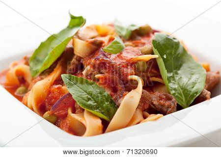 Pasta with Meat, Tomato Sauce and Basil Leaf