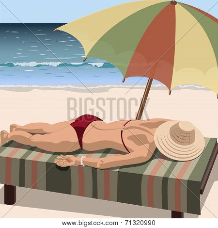 Woman sunbathes on the beach