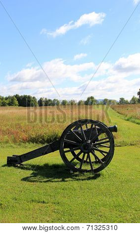 Large artillery weapon set in meadow