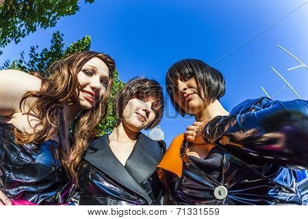 Three Girls In Black In Costume Pose At Frankfurt International Bookfair As Mangas