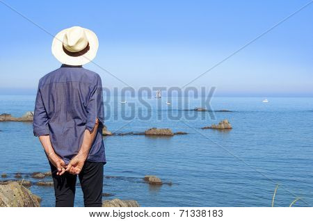 Woman Looking At The Ship Standing On The Shore, With A Hat And From Back