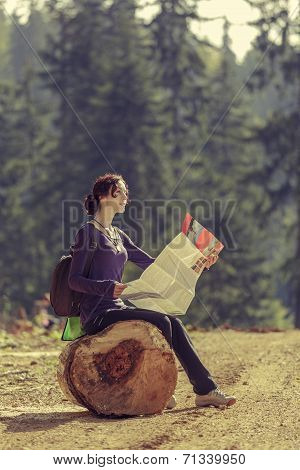 Woman Reading Travel Map