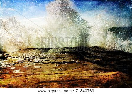 Ocean tidal Wave Crashing into a rock cliff