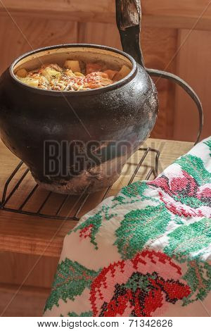 Traditional stew meal with handmade embroidery