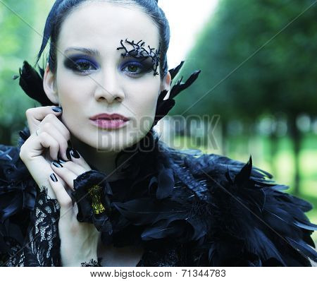 Dark Queen in park. Fantasy black dress.