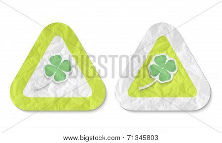 Triangles With A Texture Of Crumpled Paper And Cloverleaf