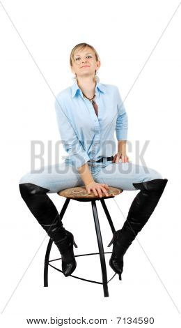 Lady In Blue Jeans Sitting On Chear