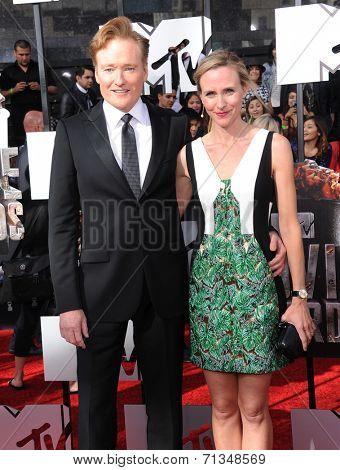LOS ANGELES - APR 13:  Conan O'Brien & Liza Powel arrives to the 2014 MTV Movie Awards  on April 13, 2014 in Los Angeles, CA.