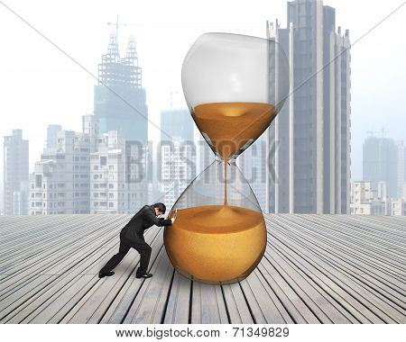 Businessman Pushing Tilt Hourglass
