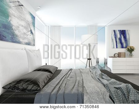 Grey and white bedroom interior with a view across a double bed to a corner view window with cabinets and a freestanding lamp with abstract art on the walls