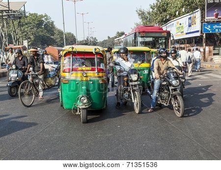 Transporting People Through City On Auto Rickshaw