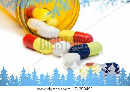 Frost and fir trees against spilled pills box