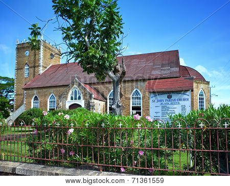 Ancient colonial church. Jamaica.Cityscape in a sunny day