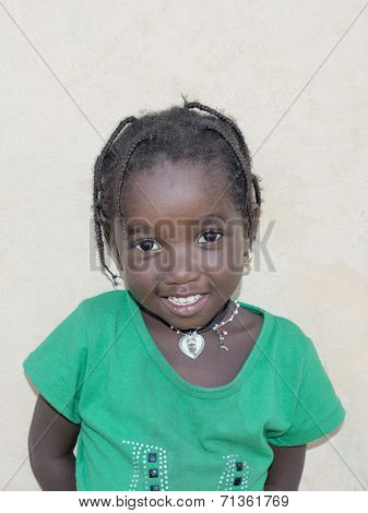Editorial caption: THIAROYE, SENEGAL, AFRICA - JULY 23, 2014 - Child in the street, popular district
