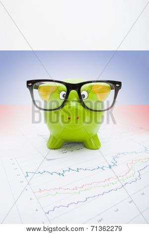 Piggy Bank Over Stock Market Chart With Russian Flag On Background - Part Of Series