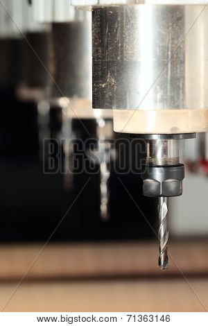 Machine is drilling wood