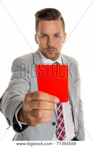 a manager holds a red card in hand. symbol photo for resignation or dismissal