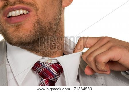 a man (manager) feels constricted. the collar bursts.