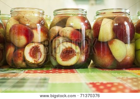 Jars of homemade fruit preserves -  peach compote