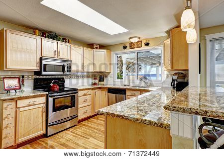 Bright Kitchen With Granite Tops And Skylight