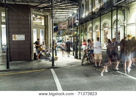 People On The Move And Bands Playing In The Burbon Street At Night