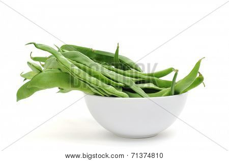 a bowl with green bean pods on a white background