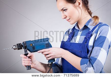Beautiful Woman Working With Drill