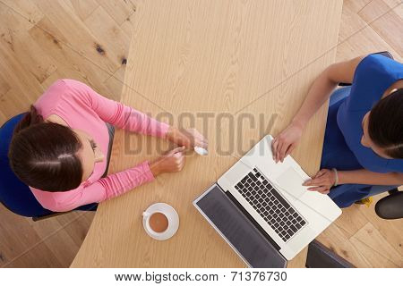 Overhead View Of Worried Woman With Financial Advisor