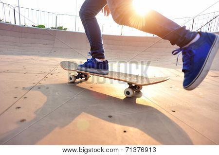 skateboarding legs at skatepark