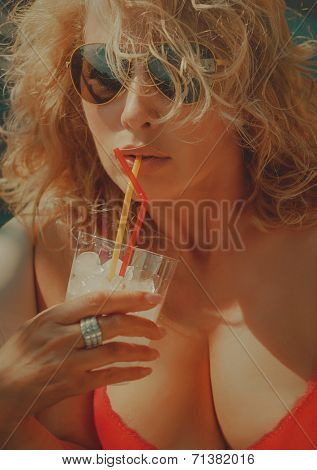 Bright picture of lovely woman with glass of cocktail