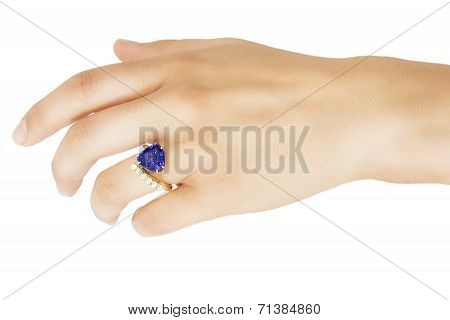 Hand with Designer Ring of Tanzanite, Diamonds and Gold, Isolated on White Background