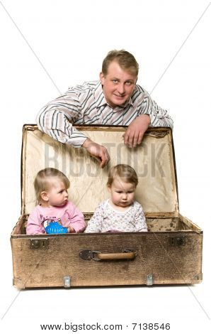 Father playing with two little children.