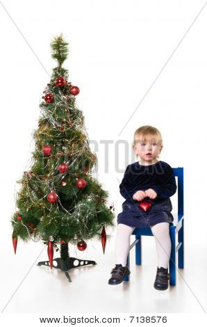 Little Girl Near The Christmas Tree