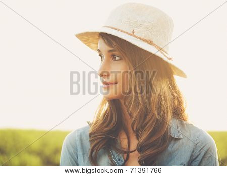 Warm Sunny Portrait of Beautiful Young Woman in the Countryside