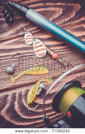 fishing tackle on a wooden table