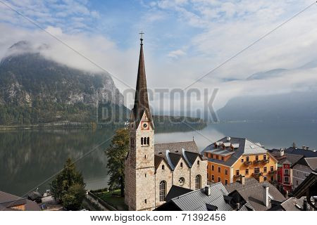 The most picturesque small town in Austria - Hallstatt. Slender belfry and Lutheran church on the shore of Lake Hallstatt.