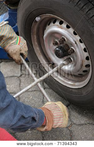 Man Changing A Car Tyre