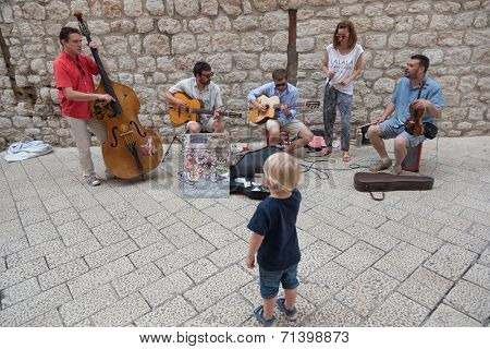 DUBROVNIK, CROATIA - MAY 27, 2014: Street musicians performing in the srteets of the old town of Dubrovnik, Croatia.