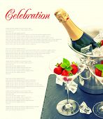 stock photo of sparkling wine  - bottle of champagne two glasses and fresh strawberries - JPG