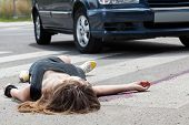 stock photo of street-walker  - Dead woman lying on a street after road accident - JPG