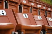 stock photo of grandstand  - Grandstand seats in the stadium are red - JPG
