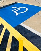 stock photo of mutilated  - The Disabled parking sign on the floor - JPG