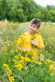foto of tansy  - Boy on meadow with tansy in summer day - JPG
