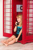 foto of child missing  - child girl calling in red in a phone - JPG