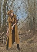 picture of early 20s  - Fashion beauty girl in fur coat standing in nature background in early spring - JPG