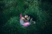 foto of lost love  - girl like a fairy sitting in grass meadow  hugs lost dog shot from above - JPG