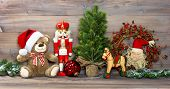 picture of nutcrackers  - nostalgic christmas decoration with antique toys teddy bear and nutcracker - JPG